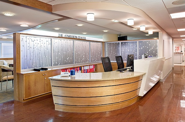 Front Desk: Diffused light and organic materials soften the concierge desk.